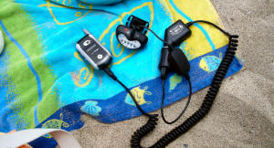 EL8 Headlamp Charging cell phone at the beach